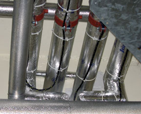 Overhead suspended pipework protected with TT1000 sensing cable.